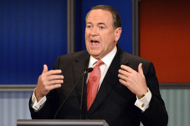 Survivor frontman Frank Sullivan sued Republican presidential hopeful Mike Huckabee, seen above in the fourth Republican debate in early November, to stop him from using Eye of the Tiger while campaigning. Photo by Brian Kersey/UPI