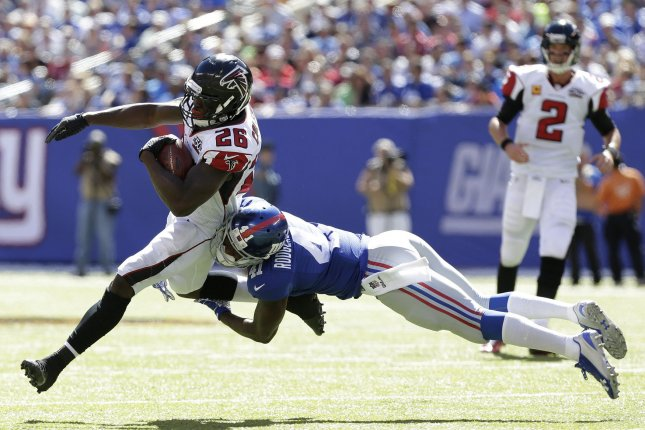 Atlanta Falcons Tevin Coleman is tackled by New York Giants Andre Williams at MetLife Stadium in East Rutherford, New Jersey on September 20, 2015. Photo by John Angelillo/UPI
