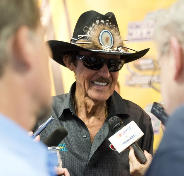 Richard Petty smiles while talking with reporters after a press conference at the NASCAR championship at the Homestead-Miami Speedway in Homestead, Fla. Photo by Gary I Rothstein/UPI