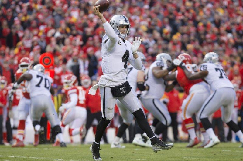 Oakland Raiders quarterback Derek Carr (4) looks to pass against the Kansas City Chiefs in the first quarter on Sunday at Arrowhead Stadium in Kansas City. Photo by Kyle Rivas/UPI