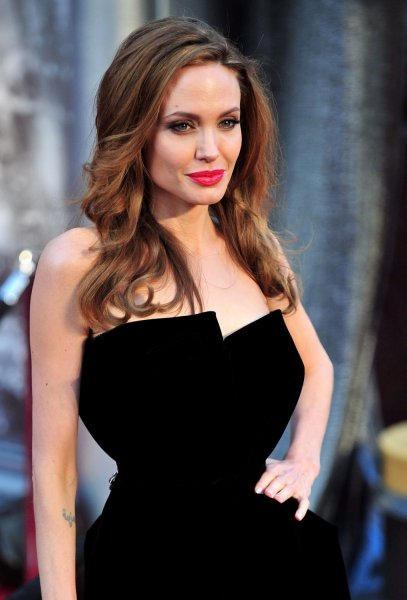 Man makes decision as Angelina Jolie -- he removes healthy organ. Angelina Jolie arrives on the red carpet at the 84th Academy Awards at the Hollywood and Highlands Center in the Hollywood section of Los Angeles. UPI/Kevin Dietsch