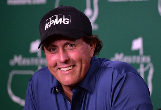 Phil Mickelson speaks to the media during a press conference before the 2016 Masters Tournament at Augusta National in Augusta, Ga., on April 5. The SEC says Mickelson reaped a $1 million profit on an insider stock tip. File photo by Kevin Dietsch