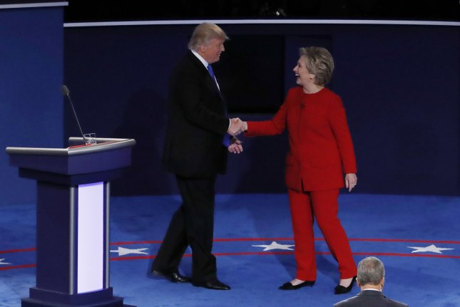 Republican presidential candidate Donald Trump shakes the hand of Democrat Hillary Clinton after the first presidential debate at Hofstra University in Hempstead, New York, on Monday. The event was the most watched political debate in American history, drawing at least 84 million viewers, Nielsen Research said Tuesday. Photo by John Angelillo/UPI