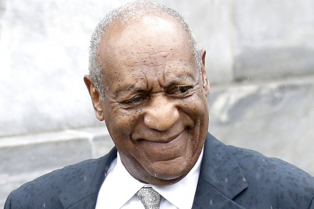 Bill Cosby smiles as he exits the Montgomery County Courthouse after a judge declares a mistrial because the jury failed to reach a verdict in the 79-year-old comedian's sexual assault trial in Norristown, Pa. on June 17, 2017. Photo by John Angelillo/UPI