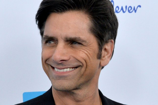 John Stamos discussed his new role as dad in interviews Thursday. File Photo by Jim Ruymen/UPI