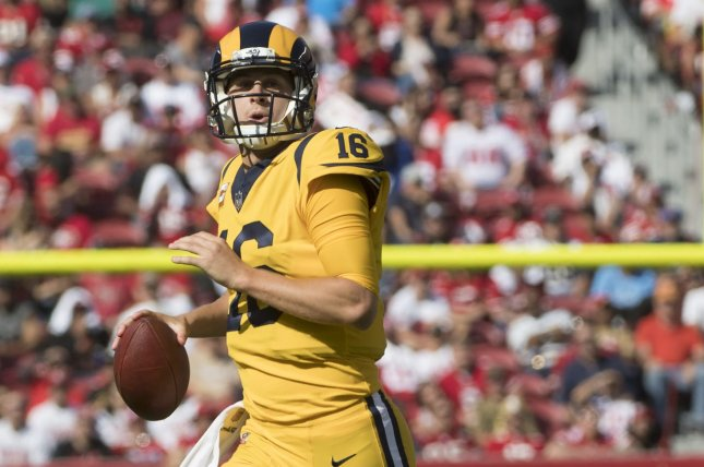 Los Angeles Rams quarterback Jared Goff (16) rolls out to pass against the  San Francisco 49ers in the second quarter on October 21 771d44982