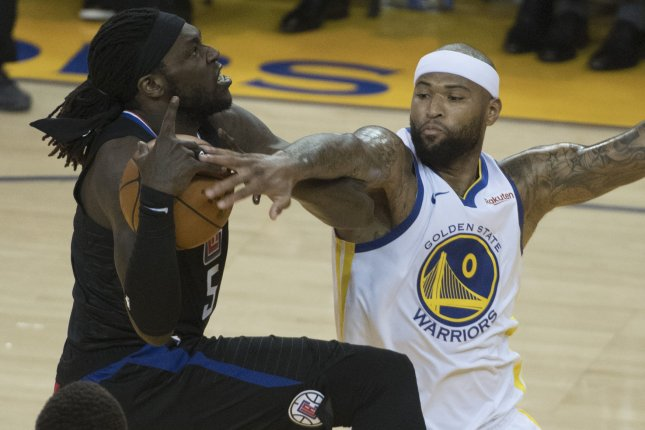 Former Golden State Warriors center DeMarcus Cousins (R) hasn't played this season because of a torn ACL in his left knee. File Photo by Terry Schmitt/UPI