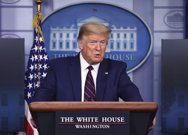 President Donald Trump on Thursday said he would expand use of the Defense Protection Act to allow six domestic manufacturers to make ventilators for COVID-19 patients as FEMA told Congress a promised stock of 100,000 will mostly not be available until June. Photo Kevin Dietsch/UPI