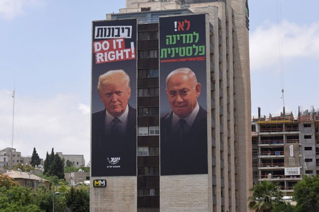 A billboard with photos of U.S. President Donald Trump and Israeli Prime Minister Benjamin Netanyahu states, in Hebrew, No to a Palestinian state, while overlooking a highway in Jerusalem, Israel last Thursday. Photo by Debbie Hill/UPI