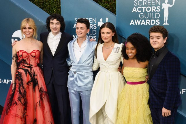 Cara Buono, Finn Wolfhard, Noah Schnapp, Millie Bobby Brown, Priah Ferguson and Gaten Matarazzo, from left to right, of Stranger Things, attend the SAG Awards in 2020. File Photo by Jim Ruymen/UPI