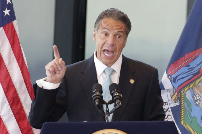 New York Gov. Andrew Cuomo speaks to reporters at One World Trade Center in New York City on June 15. File Photo by John Angelillo/UPI