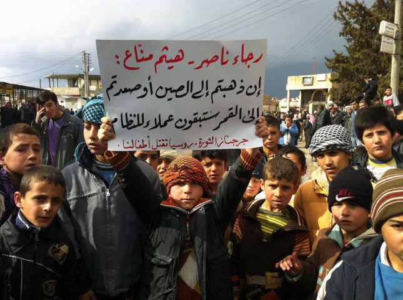 Syrians take part in a protest against Syria's President Bashar Assad in Jrbanaz near Idlib in Syria on Feb. 11, 2012. UPI