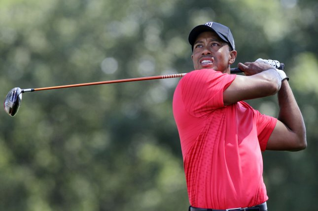 Tiger Woods, shown in a tournament last month, is tied for the lead after the first round Thursday of the PGA Championship in Atlanta. UPI/John Angelillo