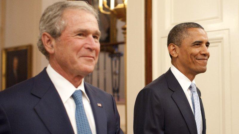 President George W. Bush, left, with President Barack Obama. UPI/Kevin Dietsch