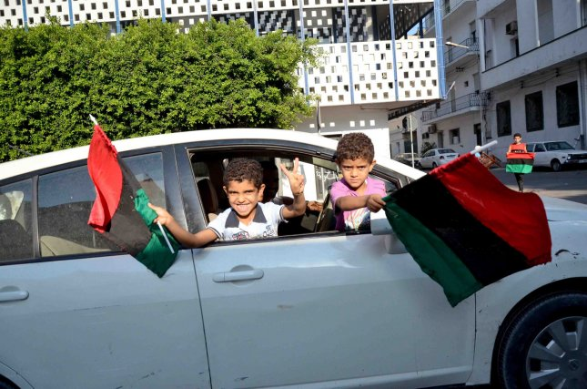Children celebrate as people tour the inside of Baba al Azizia, Moammar Gaddafi's main military compound on August 26, 2011 in Tripoli, Libya. The main compound has turned into a tourist attraction and a symbol of Gaddafi's ousted regime. Numbers of Libyans are gathering to celebrate his downfall and to tour the compound which up until August 23, 2011 has been hidden from public view until the recent surge into Tripoli by rebel forces. UPI/Tarek Elframawy