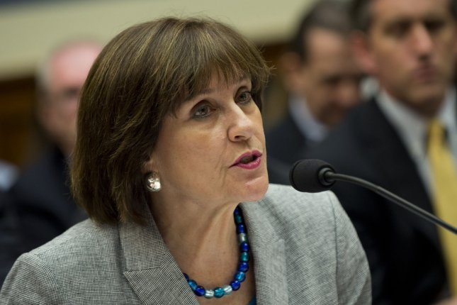 Lois Lerner, Director of Exempt Organizations for the Internal Revenue Service (IRS), invokes her fifth amendment right during a House Oversight and Governmental Reform Committee hearing on the IRS and it's targeting of conservative groups, on Capitol Hill on May 22, 2013 in Washington, D.C. UPI/Kevin Dietsch