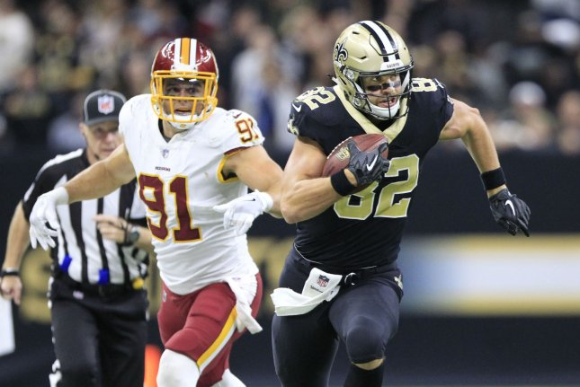 Former New Orleans Saints tight end Coby Fleener (82) runs past Washington Redskins outside linebacker Ryan Kerrigan (91) for a 29-yard gain late in the fourth quarter on November 19, 2017 at the Mercedes-Benz Superdome in New Orleans. Photo by AJ Sisco/UPI