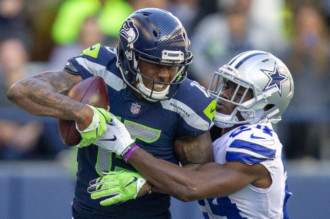cc3422d32b5 Seattle Seahawks wide receiver Brandon Marshall (15) is wrapped up after  catching a 27-yard pass against Dallas Cowboys cornerback Chidobe Awuzie  (24) ...