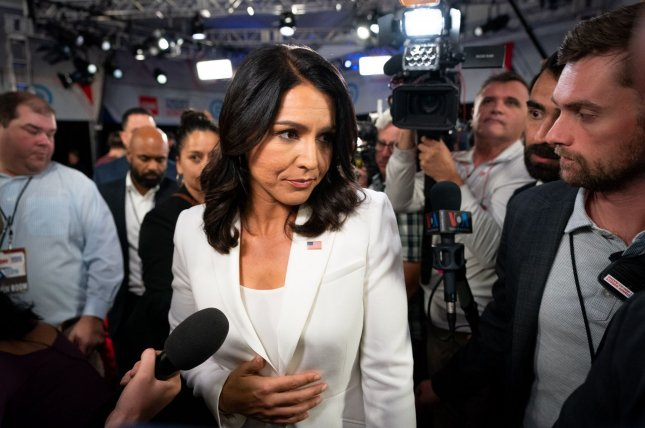 Rep. Tulsi Gabbard, D-Hawaii, speaks to reporters at a Democratic primary debate in Detroit, Mich., on July 31, 2019. File Photo by Kevin Dietsch/UPI
