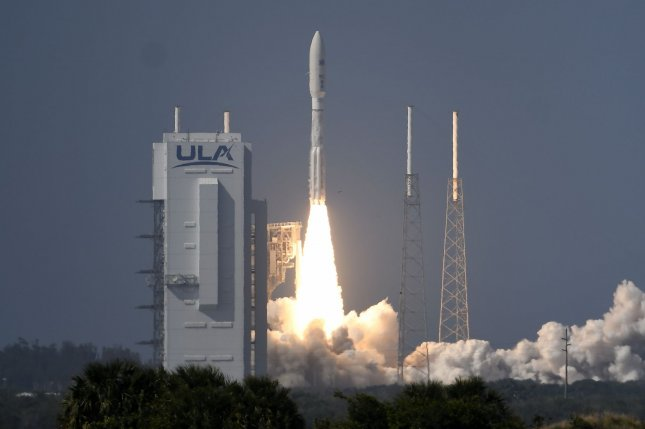 A United Launch Alliance Atlas V rocket lifts off at 4:18 p.m. EDT Thursday from Complex 41 at Cape Canaveral Air Force Station in Florida, carrying a military communications satellite. Photo by Joe Marino/UPI