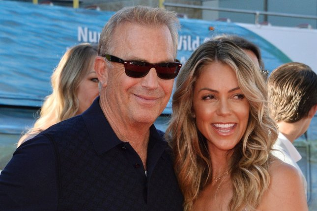 Yellowstone star Kevin Costner (L) and his wife Christine Baumgartner attend the premiere of The Art of Racing in the Rain on August 2019. Yellowstone Season 3 will be coming to the Peacock streaming service. File Photo by Jim Ruymen/UPI