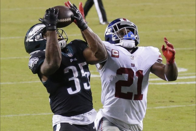 Philadelphia Eagles running back Boston Scott (35) catches the game-winning touchdown pass in a game against the New York Giants on Thursday in Philadelphia. File Photo by John Angelillo/UPI