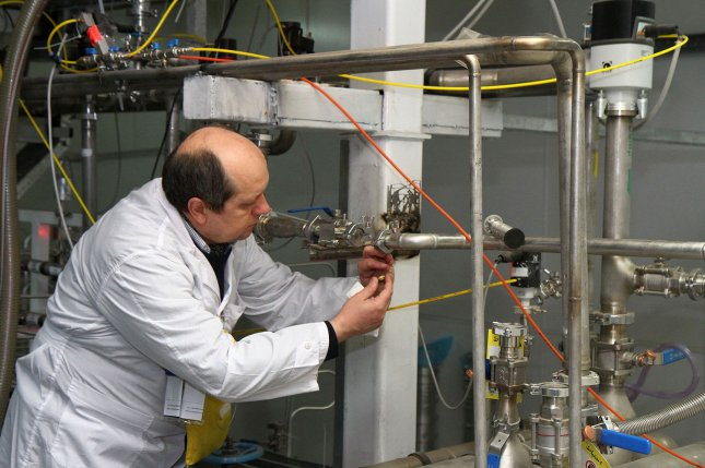 An IAEA inspector examines equipment inside the uranium enrichment plant in Natanz, Iran, in 2014. File Photo by Kazem Ghane/IRNA/UPI
