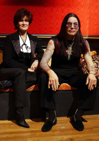 The wax figures of heavy metal musician Ozzy Osbourne and his talk show host wife Sharon are unveiled for the media on Nov. 20, 2003 at Madame Tussaud's New York museum. (UPI Photo/Ezio Petersen)