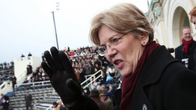 Sen. Elizabeth Warren (D-MA) waves during President Barack Obama's public ceremonial inauguration on the West Front of the U.S. Capitol in this file photo from January 21, 2013 UPI/Win McNamee/pool
