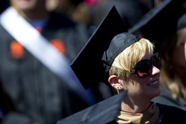 A graduate attends the 2012 Virginia Tech graduation ceremony at Lane Stadium on the campus of Virginia Tech University in Blacksburg, Virginia on May 11, 2012. A new study from NYU and affiliates suggest a correlation between longer life expectancy and post-secondary education. Photo by Kevin Dietsch/UPI