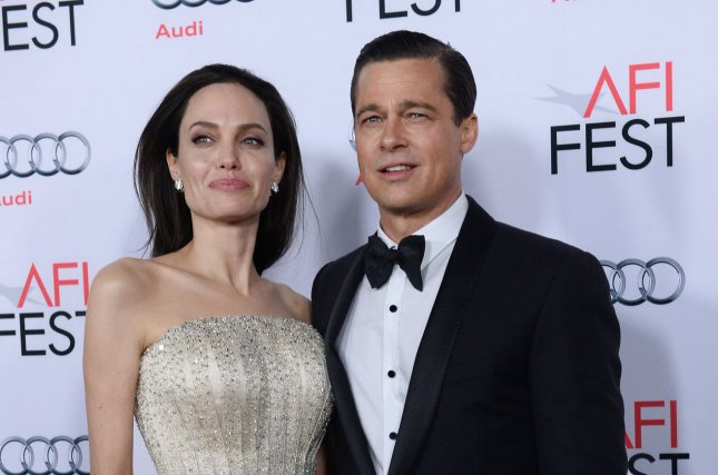 Brad Pitt (R) and wife Angelina Jolie at the AFI Fest premiere of 'By the Sea' on November 5. The actor discussed his family life with Jolie in a recent interview. File Photo by Jim Ruymen/UPI
