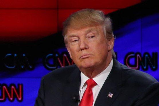 Donald Trump challenged Hillary Clinton to disarm her bodyguards. File Photos by Ruth Fremson/UPI, Matthew Healey/UPI
