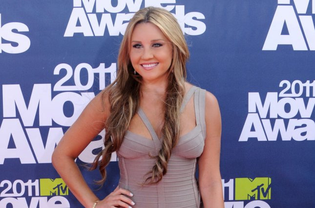 Amanda Bynes at the MTV Movie Awards on June 5, 2011. The actress returned to Twitter on Tuesday to show off her new haircut. File Photo by Jim Ruymen/UPI