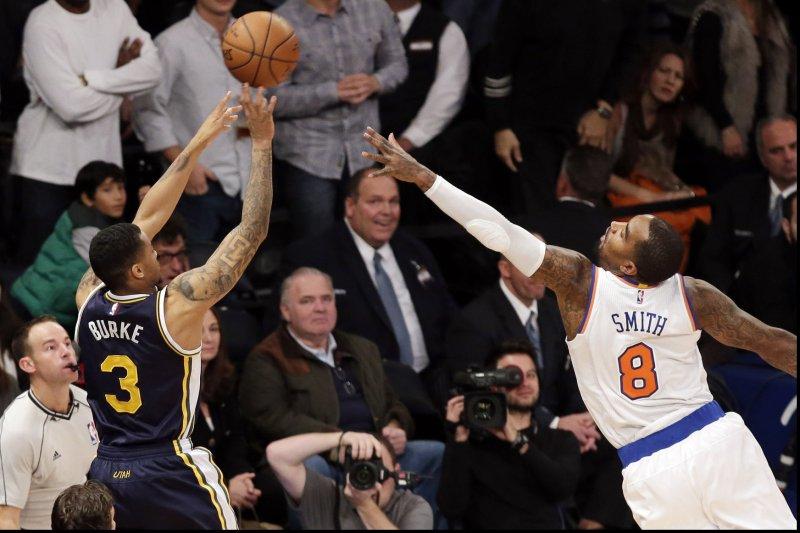 Former New York Knicks guard J.R. Smith puts his hand up to block the shot from Utah Jazz's Trey Burke. UPI/John Angelillo