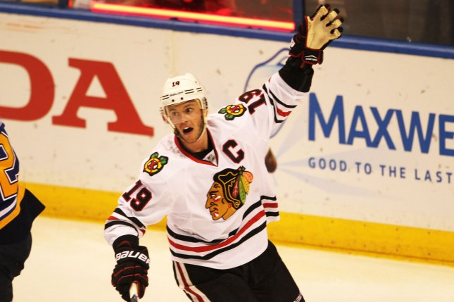 Chicago Blackhawks' Jonathan Toews recorded a hat trick as Chicago sent a message that the Central Division race might not be over yet. By beating the Wild 5-3, Chicago pulled within five points of Minnesota, which still sits atop the division. File Photo by Bill Greenblatt/UPI