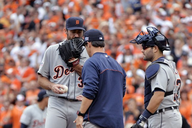 Detroit Tigers manager Brad Ausmus (C) talks to starting pitcher Justin Verlander (L). Verlander is a trade target for several teams at baseball's midseason break. File photo by Kevin Dietsch/UPI