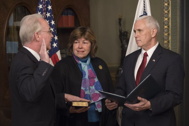 Rep. Betty Price, R-Ga., holds the bible at the Feb. 10, 2017, swearing-in of her husband, Tom Price, as Heath and Human Services Secretary with Vice President Mike Pence. Rep. Price sparked controversy Tuesday when she asked during a study committee meeting whether patients with HIV could legally be quarantined. File Photo by Pat Benic/UPI