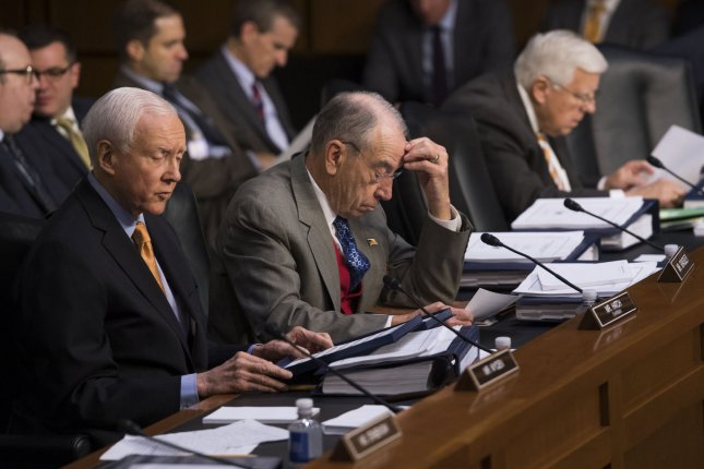 Sen. Orrin Hatch, R-Utah, Sen. Chuck Grassley, R-Iowa, and Sen. Mike Enzi, R-Wyo, participate in the Senate Finance Committee mark up of the Republican tax bill. Photo by Kevin Dietsch/UPI