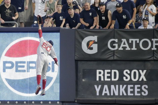 0c5051e03 Boston Red Sox outfielder Mookie Betts fails to make a catch on a ball hit  by the New York Yankees  Didi Gregorius in the first inning on July 1 at  Yankee ...