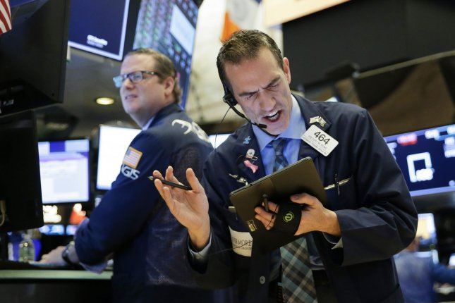 Traders work on the the floor of the New York Stock Exchange at the opening bell on Wall Street in New York City on Friday. Stocks continue to fall on coronavirus fears. Photo by John Angelillo/UPI