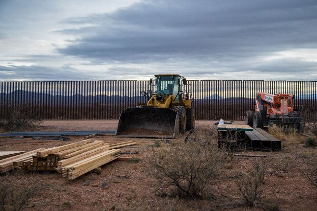 A section of the border fence in Naco, Ariz., is being replaced with modern barriers on February 14, 2019. On Tuesday, the Government Accountability Office said President Joe Biden didn't break the law when he froze funding for building the southern border wall. File Photo by Ariana Drehsler/UPI