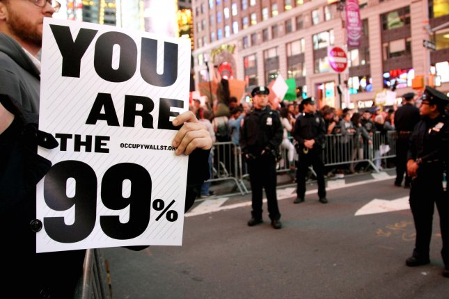 Police keep an eye on the thousands of protestors who are taking part in the Occupy Wall Street rally in Time Square as they call for the end of corporate greed on October 15, 2011 in New York City. Similar demonstrations are being held today around the world as protestors call for a reform in capitalism policies. UPI/Monika Graff