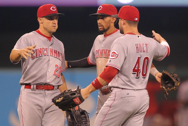 Cincinnati Reds ( L to R) Adam Duvall, Billy Hamilton and Tyler Holt come together for a group hug after defeating the St. Louis Cardinals 7-4 at Busch Stadium in St. Louis on August 9, 2016. Photo by Bill Greenblatt/UPI