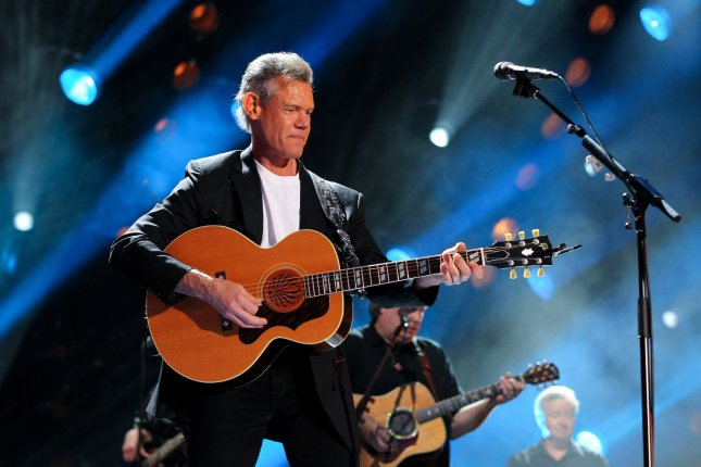 Randy Travis, pictured at the CMA Music Festival in 2013, sang the first verse of Amazing Grace Sunday night after being inducted into the Country Music Hall of Fame just three years after he had a debilitating stroke connected to viral infection in his heart. File photo by Terry Wyatt/UPI
