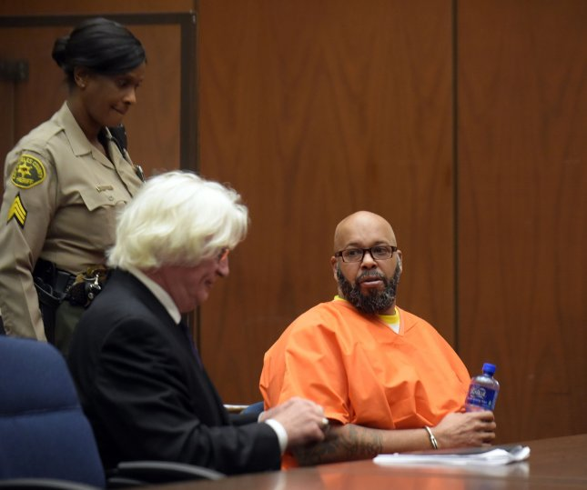 Marion 'Suge' Knight (R) makes a court appearance with his lawyer Thomas Mesereau, for assault and robbery charges at the Criminal Courts Building in Los Angeles, on May 29, 2015. He was later charged with threatening to kill film director F. Gary Gray and pleaded not guilty to the charges on Aug. 3. Pool photo by Frederick J. Brown/UPI