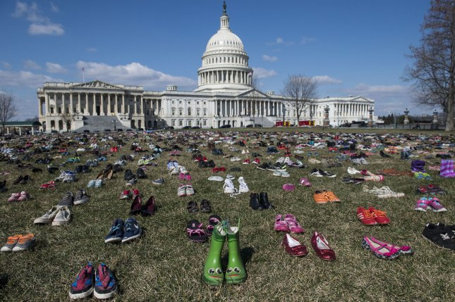The House passed a school safety bill Wednesday that provides funds for training to stop acts of school violence before they happen. The legislation doesn't address gun control, something thousands of students called for as they walked out of school. Photo by Kevin Dietsch/UPI