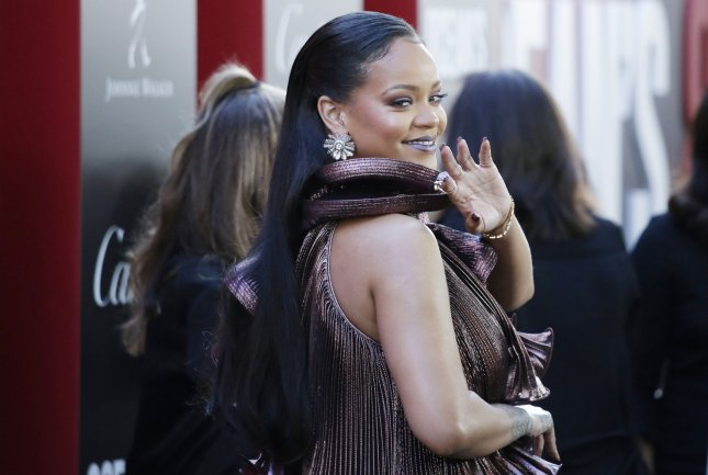 Rihanna waves when she arrives on the red carpet at the 'Ocean's 8' World Premiere at Alice Tully Hall on June 5 in New York City. This month, Rihanna was named an ambassador of Barbados. File Photo by John Angelillo/UPI