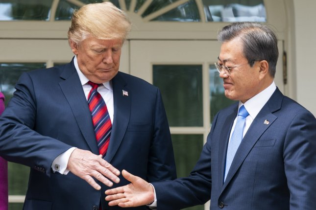 Former U.S. President Donald Trump (L) and South Korean President Moon Jae-in (R) appeared to agree publicly but the two sides struggled to reconcile differences amid Trump's defense-cost demands. File Photo by Jim Lo Scalzo/UPI