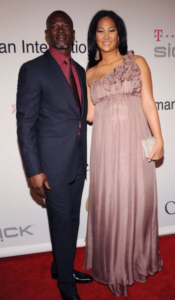 Actor Djimon Hounsou and designer Kimora Lee arrive at the Clive Davis pre-Grammy party in Beverly Hills, California on February 7, 2009. (UPI Photo/Jim Ruymen)