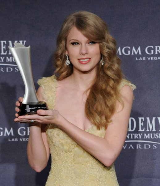 American country music have crowned a pair of new queens, barraging Miranda Lambert with four major honors for her hit The House That Built Me. while the public voted superstar Taylor Swift (pictured) as the Entertainer of the Year. Swift appears backstage with her award at the 46th annual Academy of Country Music Awards in Las Vegas on April 3, 2011. UPI/Jim Ruymen